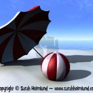 Sun parasol and beach ball on a beach